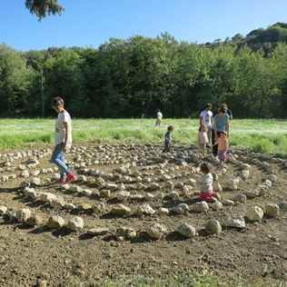Visitors walk the Labyrinth
