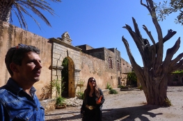 Ivana is being given a private tour at the Monastery of Arkadi
